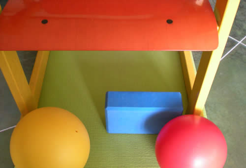 Nice colors: chair, yoga block & mat, Yamuna balls
