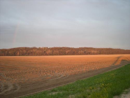 Light on the fields.  There's a faint rainbow on the left.