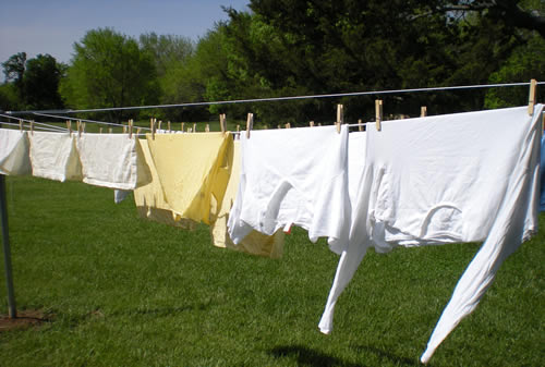 We put up a clothesline for energy-saving reasons.  The dry clothes are a little crispy but they mell great.