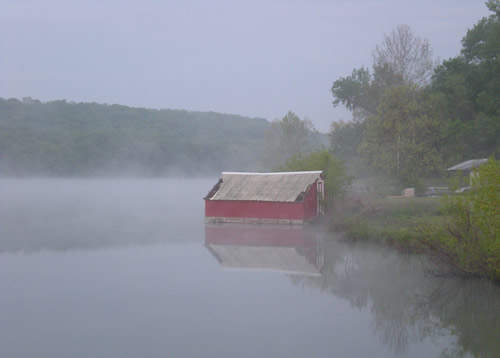 Undocked boathouse on a foggy morning