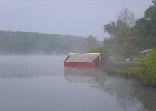 Undocked boathouse on a foggy morning