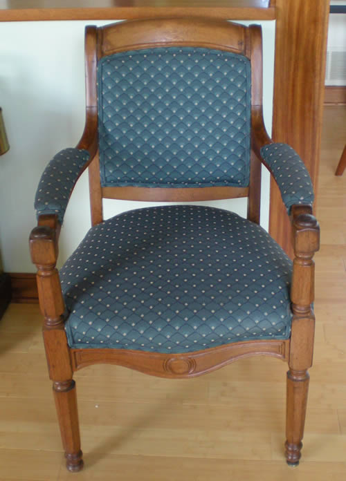 This was my grandmother's chair, and then it belonged to my parents.  When I got it, it was upholstered in black leather and electrical tape.  The feet don't match, but it's not crooked.  It's a good chair for someone with a bad back, because it's higher than a normal chair.