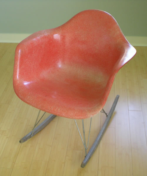 WE always call this the Herman Miller chair.  Never the red chair, or the red rocker.  My father-in-law gave it to us many years ago.  We didn't know it was a collector's item and for a while left it out on the porch.  It's in our bedroom now, where it looks good and we try not to let it become a dirty clothes receptacle.