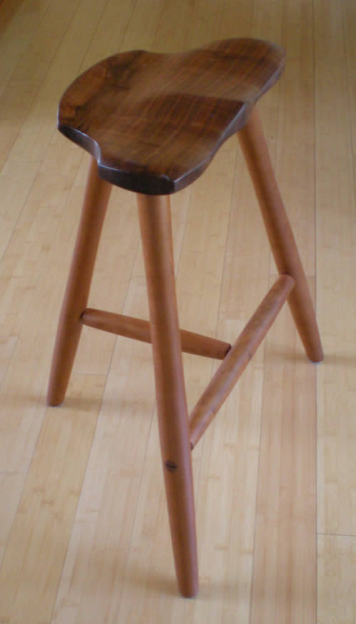 Edzo made this stool for me.  It lives in the kitchen.  It's both beautiful and functional.