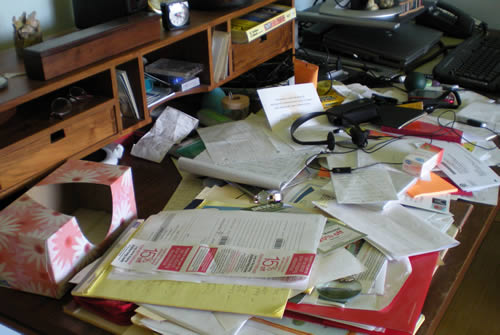A couple of times a year I get disgusted by the state of my desk and clean it up.  I rarely lose something here, though.