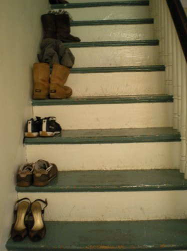 The staircase is a good place for shoe storage.