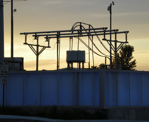 When we were waiting for the bus in Kansas City ten days ago, I took this picture of some sort of electric station.  The blue panels were glowing.