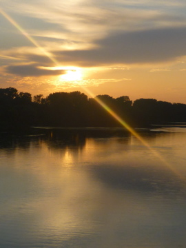 The sun set on the Kaw River just as I was driving over the Lecompton bridge.  I snapped this from the car.