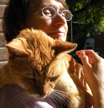 I'd like to write a eulogy here for Joe Fish, prince among cats.  He's 17 now, and his end is very near.  Here he is with the person who loves him the most.