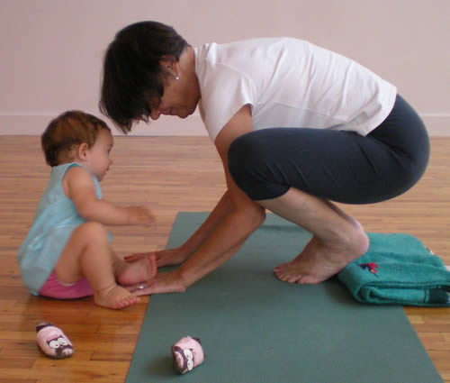 Evy sometimes comes to yoga practice with her mother and grandmother.  She is a completely charming yoga partner.