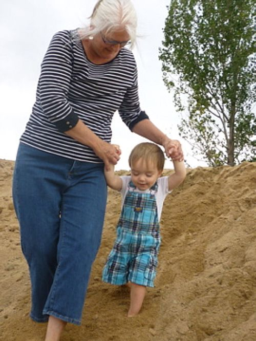 Campbell and Grandma Fishes (he can't say Phyllis) climbed the sand hill again and again.  We were both delighted in such innocent fun!