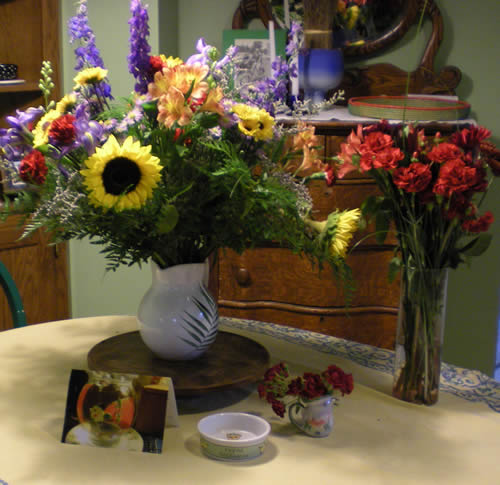 After Joe Fish's death, my sister received flowers and gifts in his memory from people who loved him and love her. The card is a photograph of Joe's drinking bowl, which was a goldfish bowl with glass fish that sat on the coffee table.  The little dish was, well, his little dish.