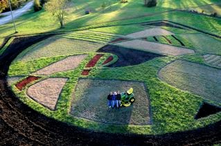 Here's the finished crop art piece in our front pasture by Stan Herd.  Kevin Roberts sent this image to us.  He was in the bucket lift and shot this from there.  The image isn't really visible from the ground.  Stan's expertise in creating these images to be seen from the air is amazing.