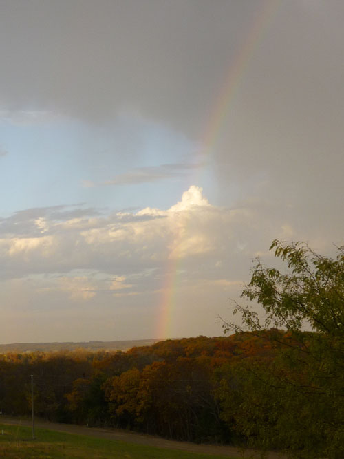 As the sun set today, a rainbow spread across the sky.  I caught it just before the eastern horizon disappeared.