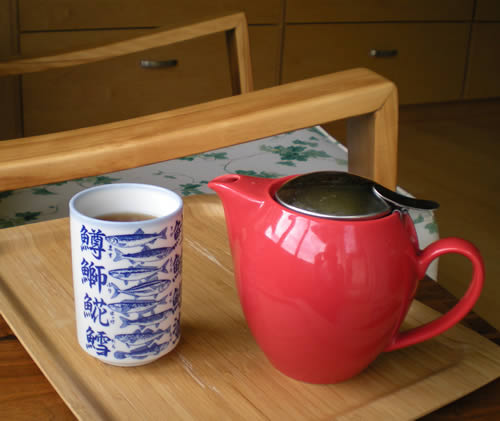 A comfy chair and tea in a pretty cup