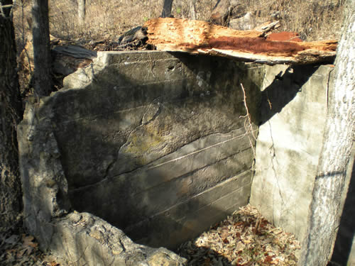 Dilapidated cement cold cellar
