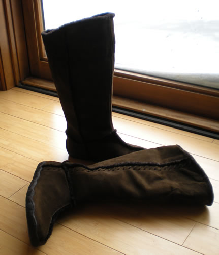 brown winter boots by the door, snow outside