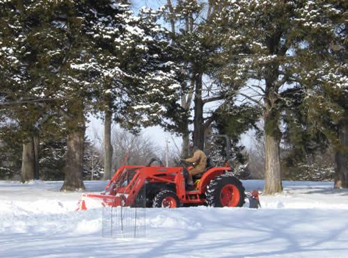 Orange tractor in snow