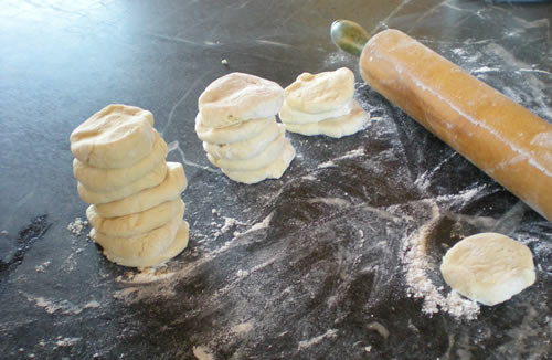 stacked circles of dough, rolling pin
