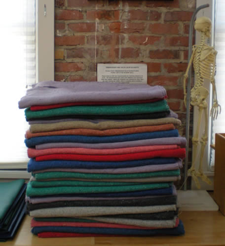 Stack of yoga blankets, plastic skeleton