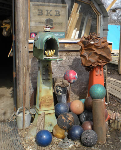 Assemblage of bowling balls, mailbox, other detritus