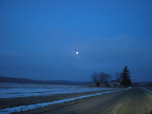 Dawn moon over fields