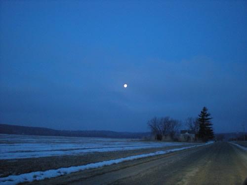 Dawn moon over fields