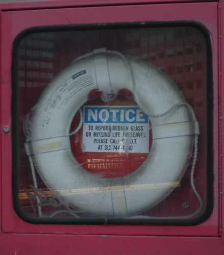 life preserver behind glass in city