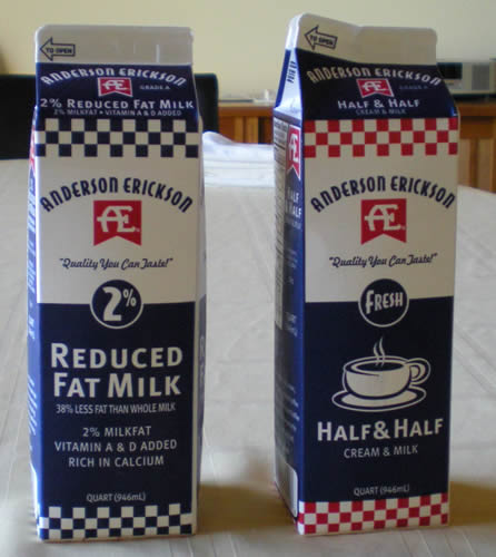 almost identical milk and half and half cartons side by side.