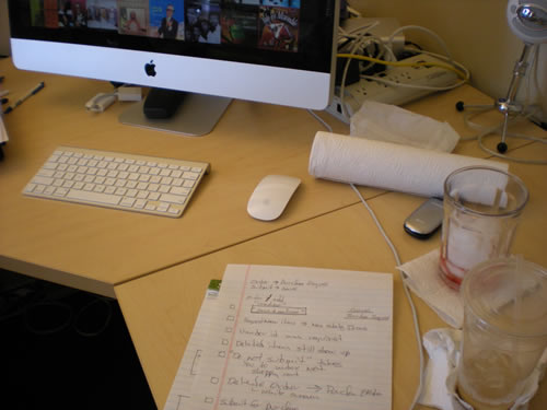 desktop, papers, computer, water glass, paper towel