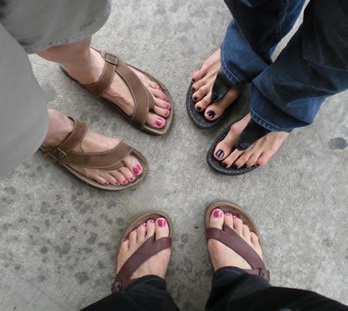 Three sets of freshly polished toenails