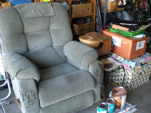 old recliner, paint cans, other stuff