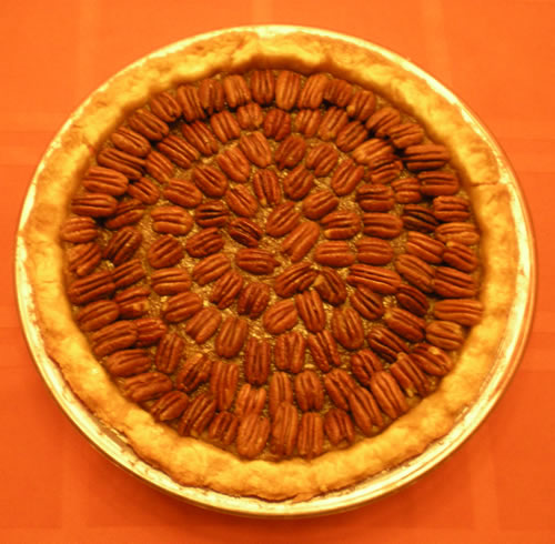 pecan pie on orange tablecloth